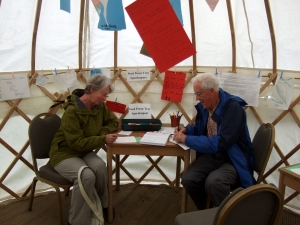 The Bennetts writing poetry in the Yurt today.
