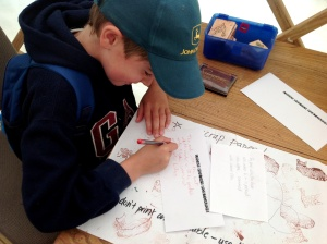 Joe working on his Logan Poetry Postcard